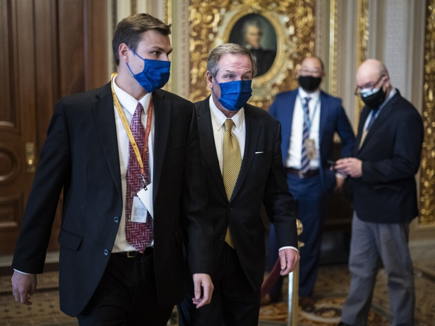 Michael van der Veen, lawyer for former President Donald Trump, walks to the Senate floor through the Senate Reception room on the fourth day of the Senate Impeachment trials for former President Trump at the Capitol on Friday.