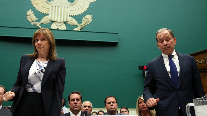 GM CEO Mary Barra and Anton Valukas, head of GM's internal recall investigation, stand at the witness table during a House Energy and Commerce Committee hearing on Capitol Hill Wednesday.