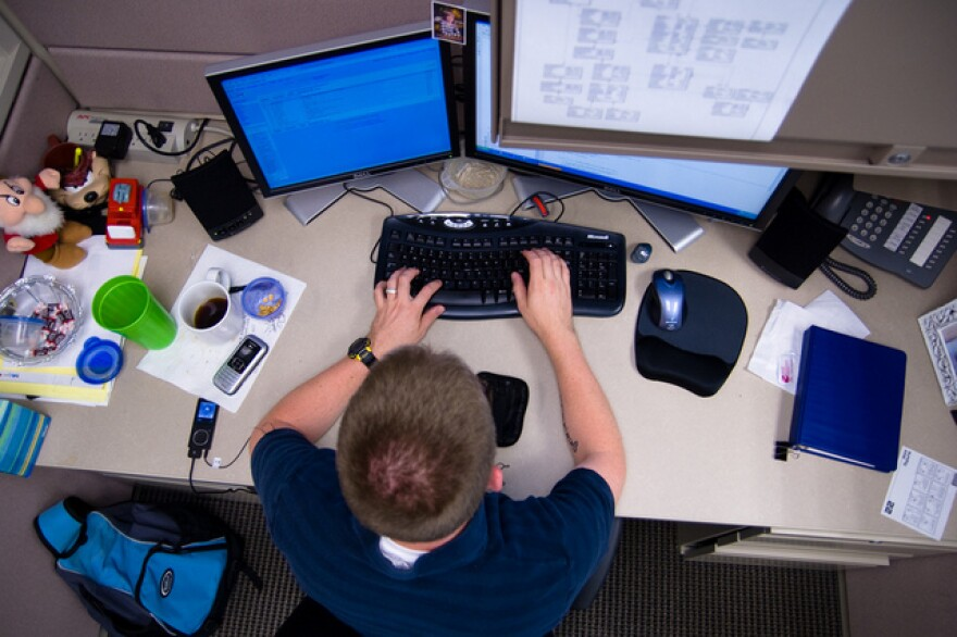 Man at Desk using computer - Overhead shot - Photo By Caleb Miller (2).jpg