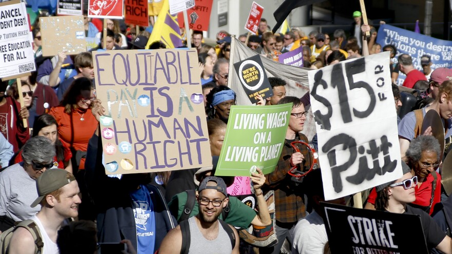 Union organizers, students and supporters for a $15 an hour wage march in Pittsburgh in April. Washington, D.C., is the latest city to move toward the wage increase.