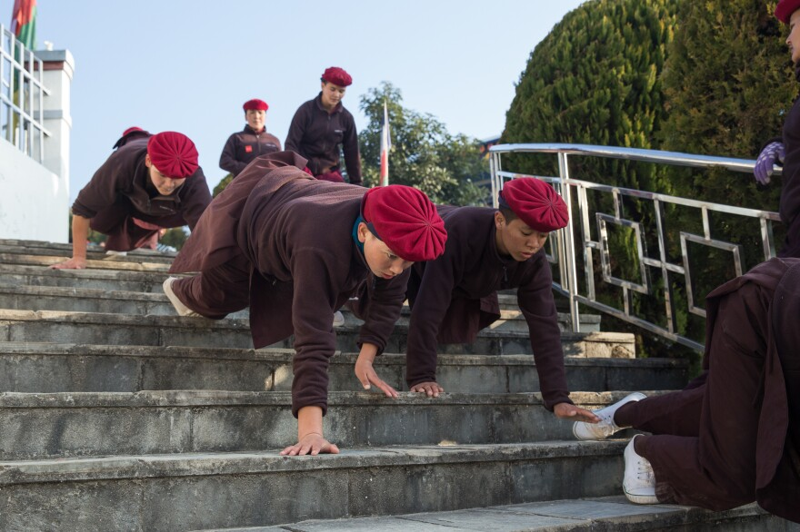 Nuns crawl down 200 stairs as a part of their morning warm-up.