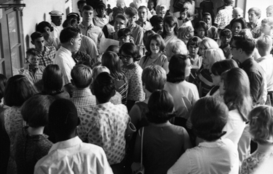 Rickards High School students look for a counselor on the first day of desegregated classes in the 1967 school year.