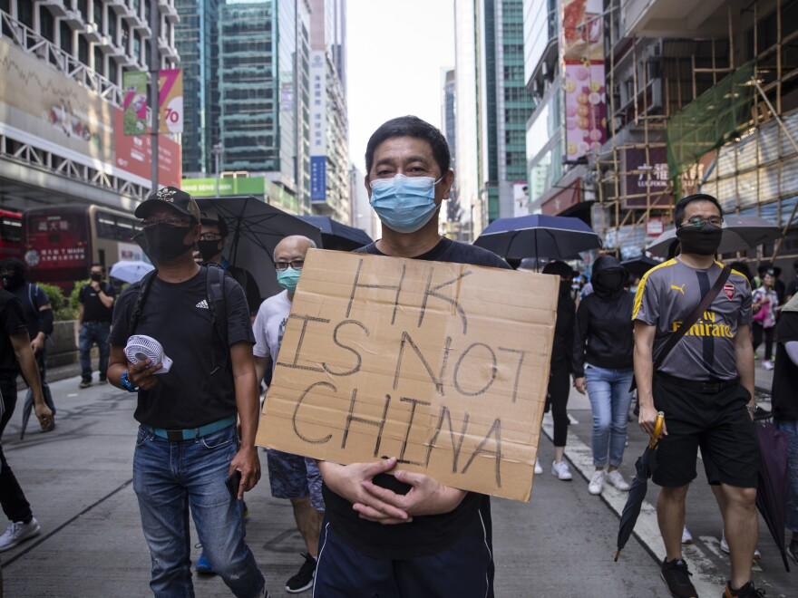 A pro-democracy demonstrator protests in the Mong Kok district of Hong Kong on Tuesday.