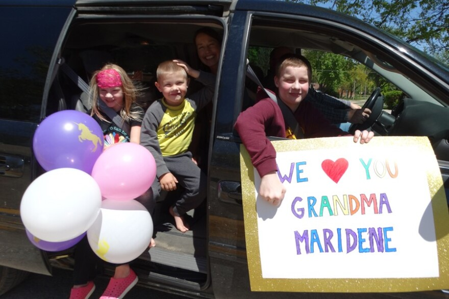 Maridene Lundstrom's family poses with balloons and a sign they brought to the parade around Bethany Home. (Photo courtesy of Jennifer Cantrell)