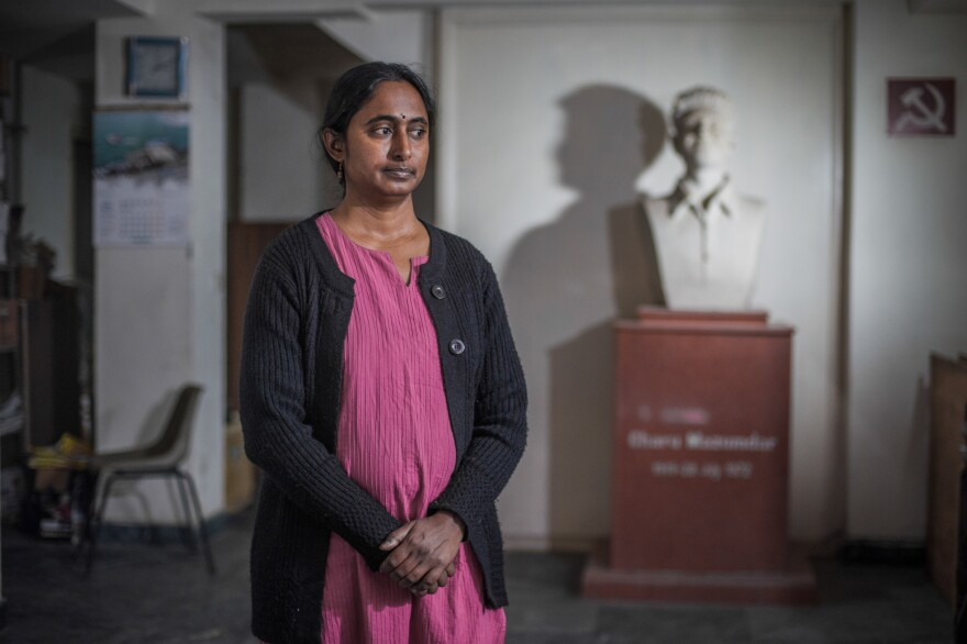 Kavita Krishnan, secretary of the All India Progressive Women's Association, photographed in the offices of the Communist Party of India. The bust in the background depicts Charu Majumdar, a Communist revolutionary from Bengal.