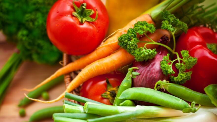 Fresh vegetables in a basket.