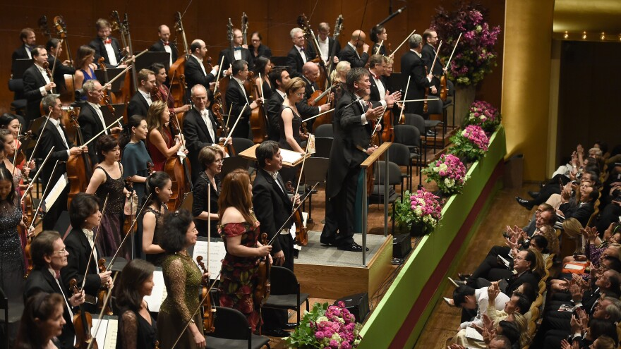 Members of the New York Philharmonic, led by music director Alan Gilbert, during the opening of a new season on September 21, 2016 in New York.