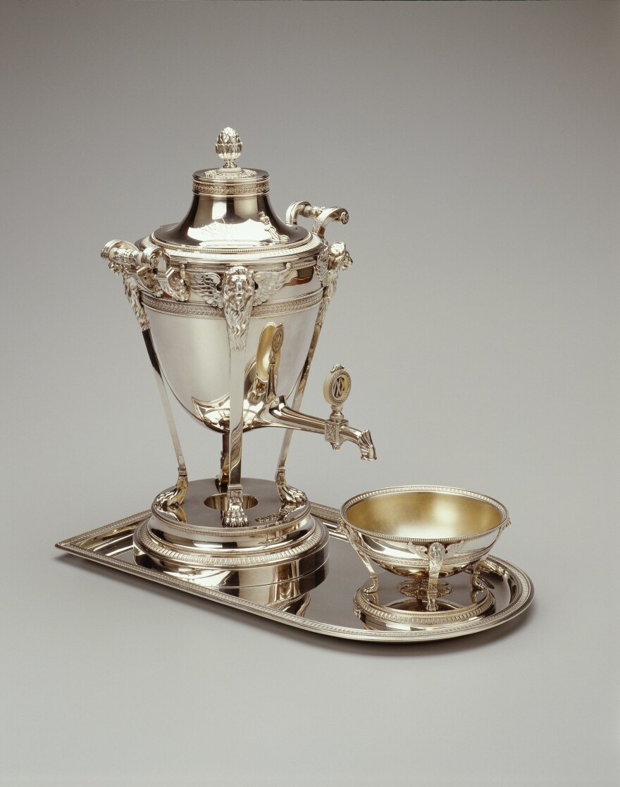 This samovar, made in Moscow in 1909, was part of a grand tea set crafted by the First Silver Artel, a firm that often, as in this case, supplied works to the Faberge firm for retail. The marks of both Faberge and the First Silver Artel appear on the samovar.