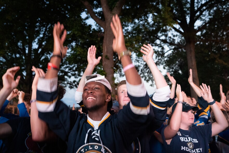 """Cameron Mason, 18, of St. Louis leads Blues fans in the """"Power Play Dance"""" at the Game 6 watch party downtown."""
