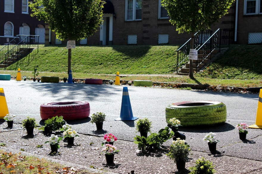 Brightly-painted tires, cones and fake flowers were set up to show flower bed build outs could narrow roads and encourage drivers to slow down Sat. Oct. 10, 2015 in St. Louis' Dutchtown neighborhood.