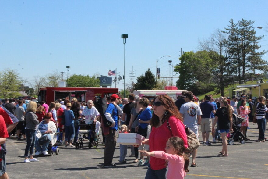 Food trucks serving everything from pizza to barbecue, Greek food to waffles lined the parking lot of the vacant Crestwood mall.