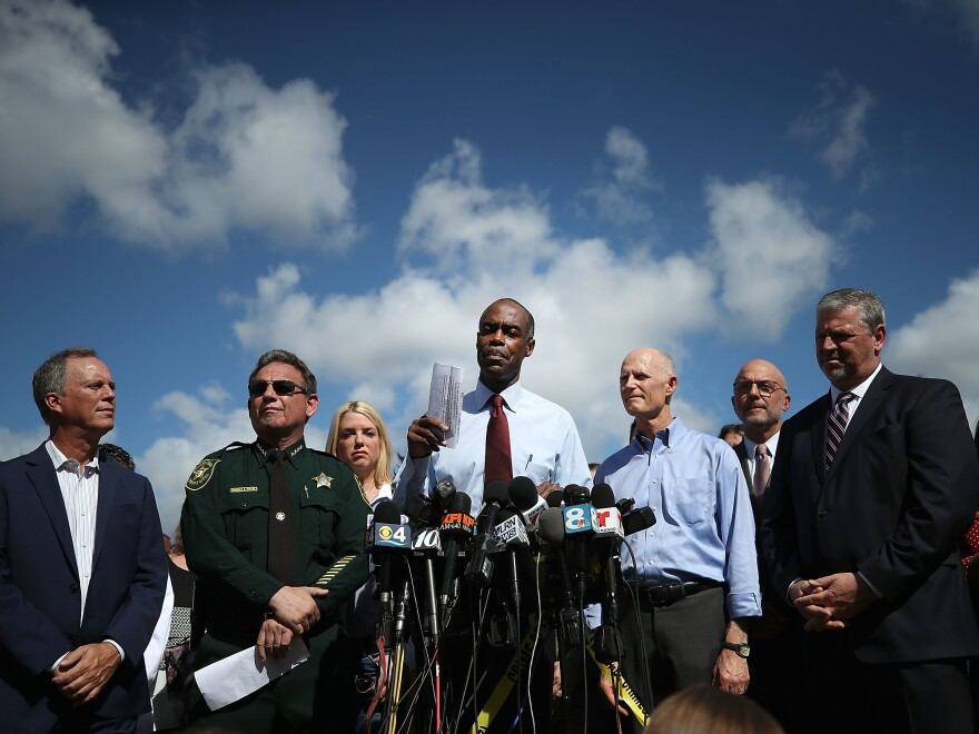 Broward County Public Schools Superintendent Robert Runcie speaks at a news conference Thursday, as county Mayor Beam Furr (from left), Broward Sheriff Scott Israel, Gov. Rick Scott and FBI agent Robert Lasky look on.