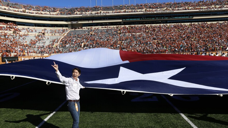 Members of Alpha Phi Omega handle the world's largest Texas flag before University of Texas football games. Like the flag, it's a big deal.