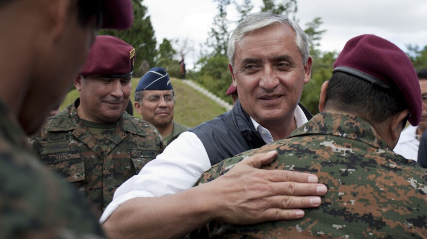 Newly elected president Otto Perez Molina greets members of Guatemala's elite special forces in December. Perez takes office Saturday with a top priority of ending a long-standing U.S. ban on military aid.
