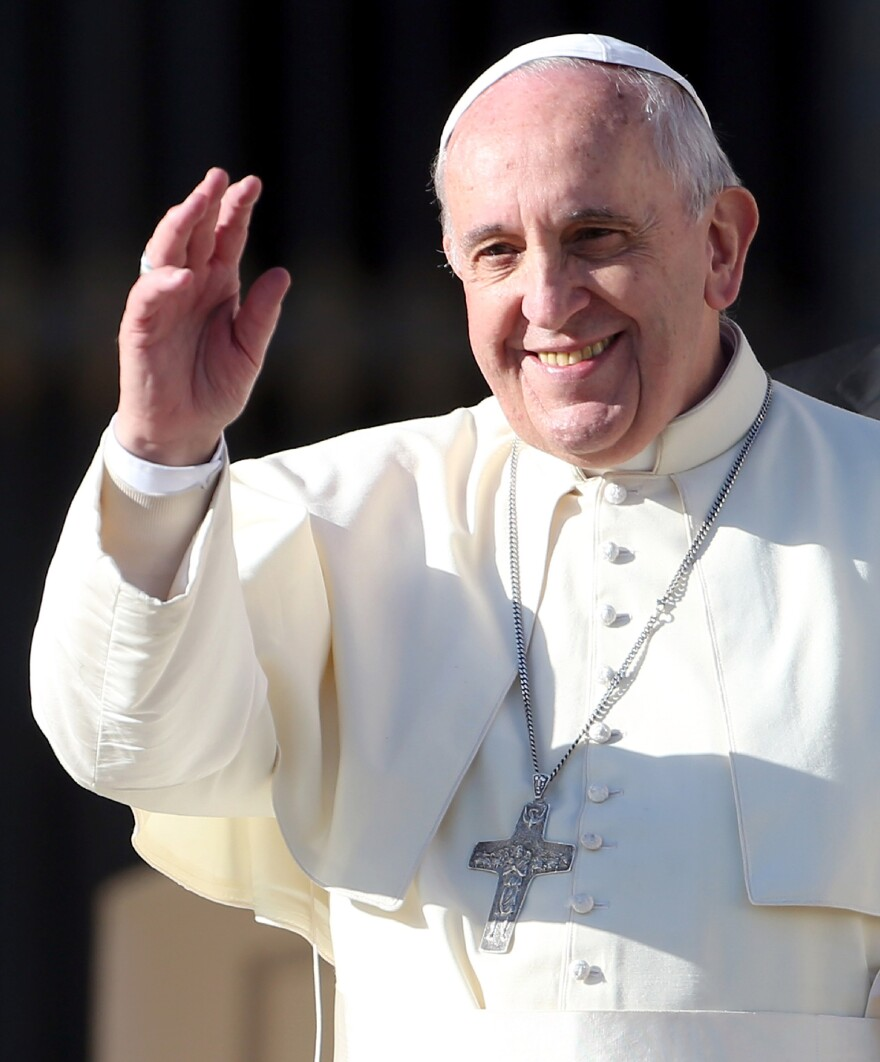 Pope Francis waves to the faithful as he arrives in St. Peter's Square for his weekly audience, on Dec. 17, in Vatican City. Even among non-Catholics, the pope's popularity is high.