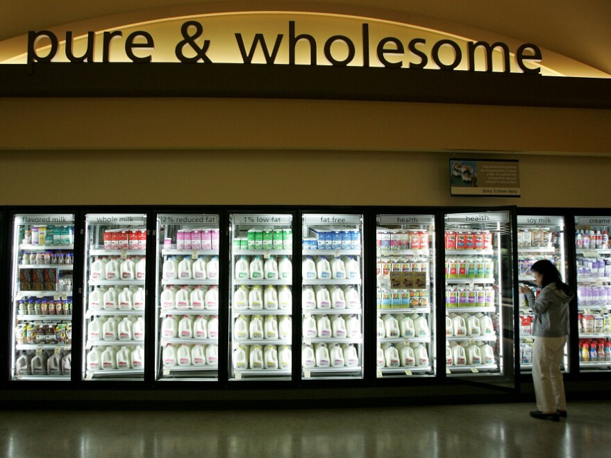 A Safeway customer shops for milk in Livermore, Calif.