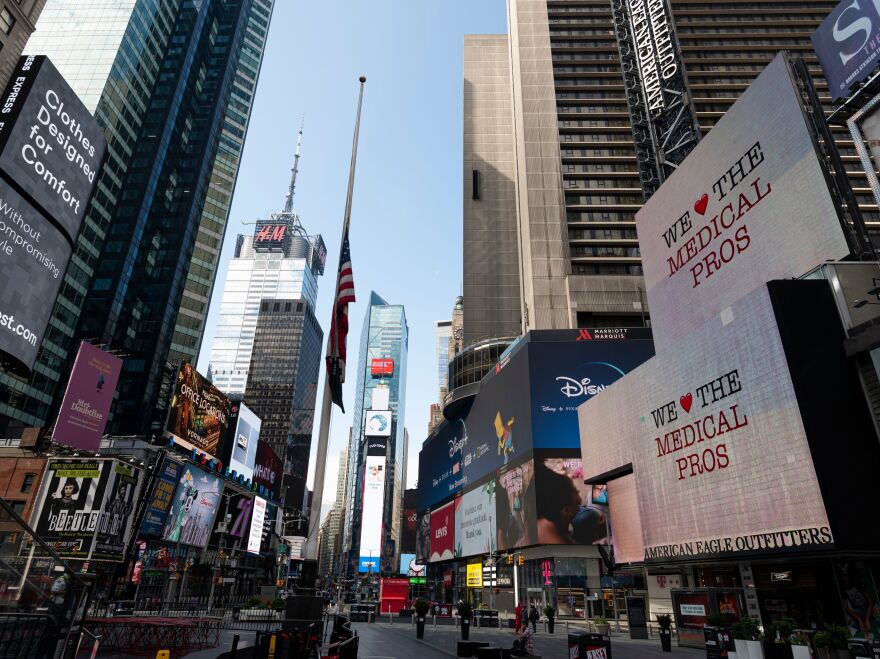 Few people are seen at Times Square on Friday. Retail sales plummeted 16.4% in April, a record drop, as millions of Americans stayed home.