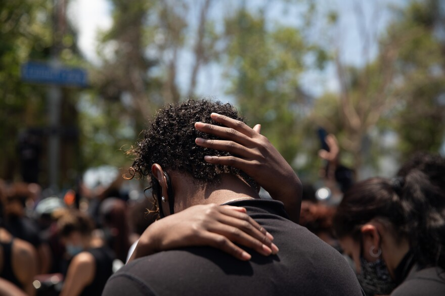 A parent and child share a tender moment during a protest against police brutality in Los Angeles on June 6.