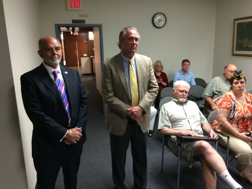St. Louis County Circuit Court Judge Doug Beech, far left, and Bill Wallace watch a press conference celebrating the approval of a resolution support county veterans courts.