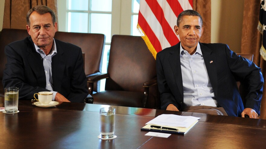 """House Speaker John Boehner, R-Ohio, and President Obama at the White House on a Saturday in July, a day after Obama told reporters he had been """"left at the altar"""" by Boehner."""