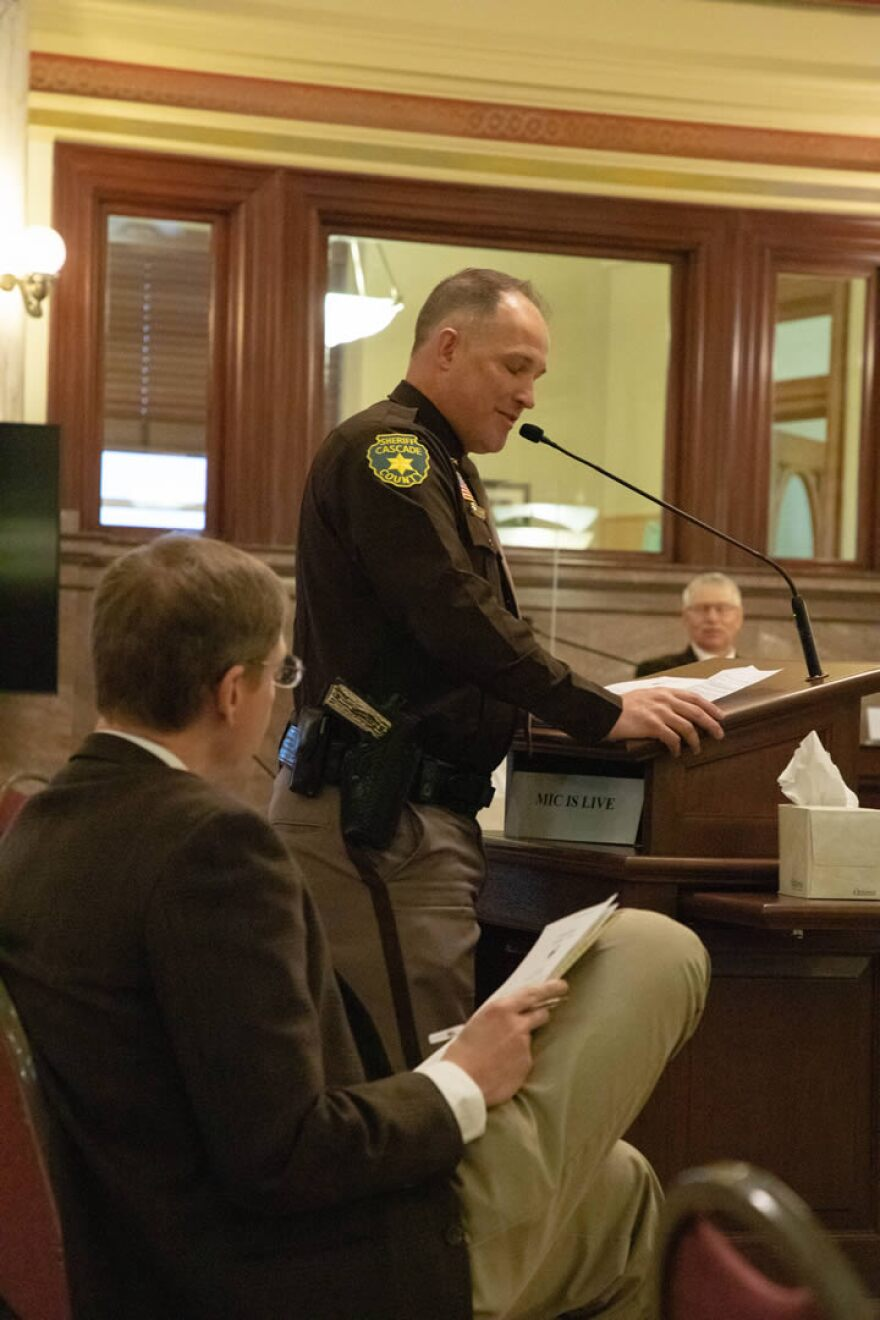 Cascade County Sheriff Jesse Slaughter (right) thanks Sen. Steve Fitzpatrick, R-Great Falls (left), for sponsoring Senate Bill 67, which would remove penalties for law enforcement failing to enforce local health directives, at a meeting of the Montana Senate Judiciary Committee January 13, 2021.