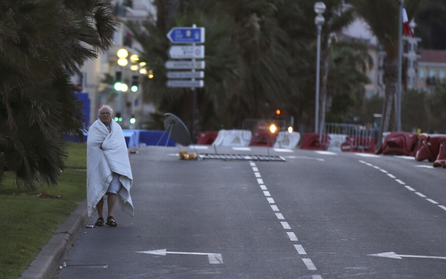 In the early hours of Friday morning, a man walks near the scene of the previous evening's attack.