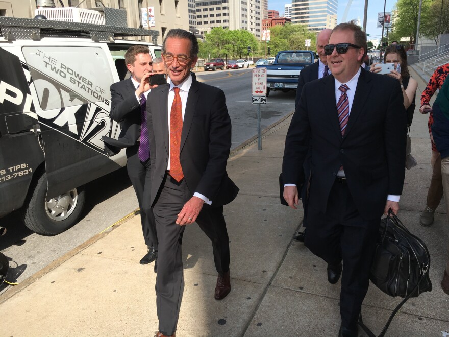 Attorney Al Watkins, pictured here walking out of court on May 1, 2018 with his then-attorney Chuck Hatfield, has admitted he violated a gag order in the Eric Greitens case.