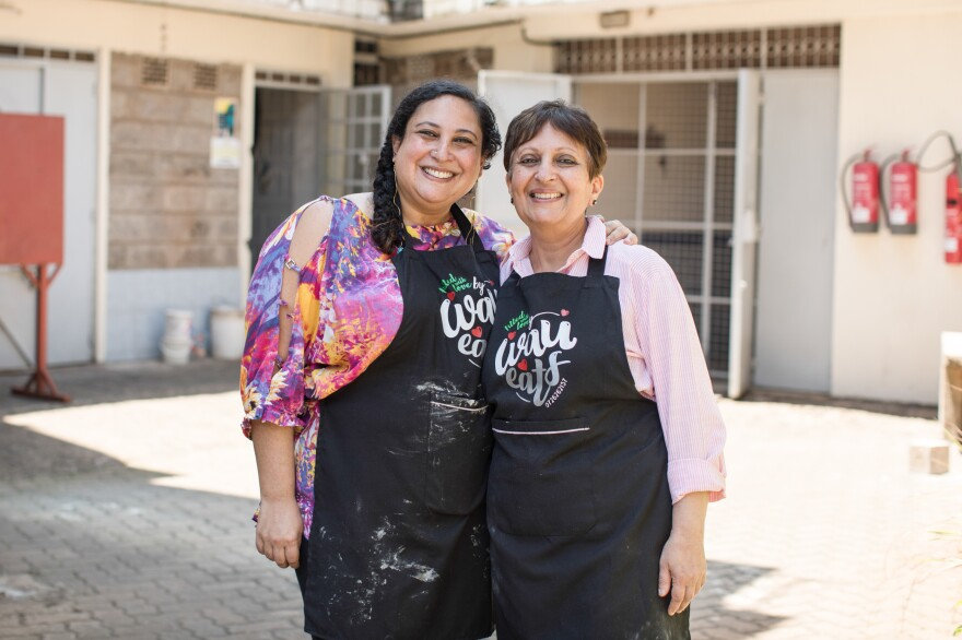 Aleya Kassam, left, and her mother, Narmin, pose for a portrait outside the apartment they rented to run their growing samosa business.