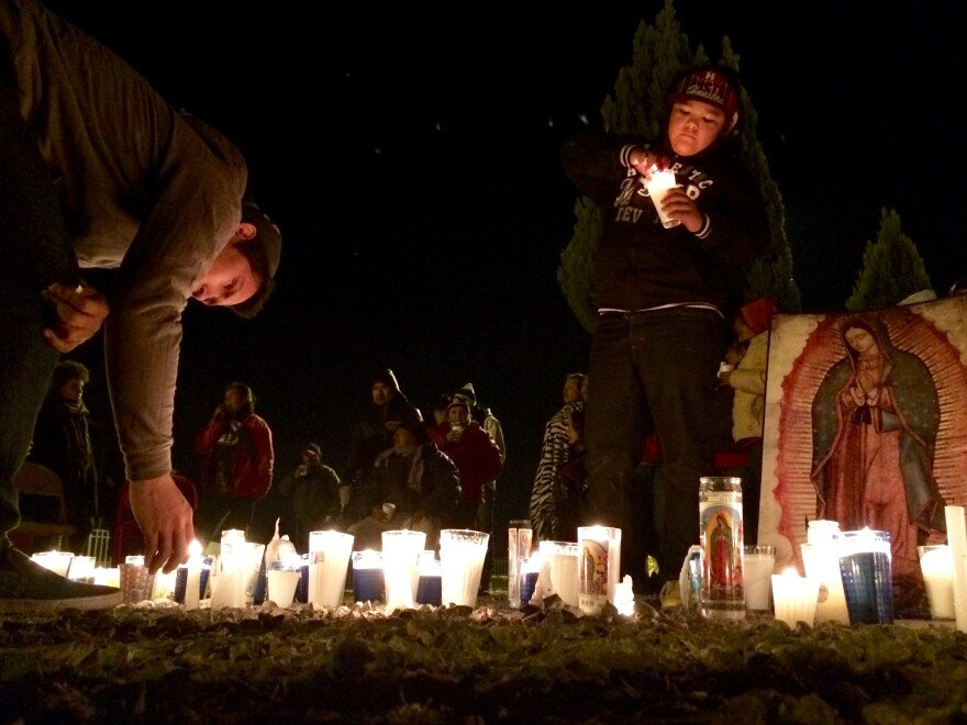 Children light candles during an overnight vigil at a protest camp in Juarez, Mexico, outside the manufacturing plant for the American-owned printer company Lexmark.