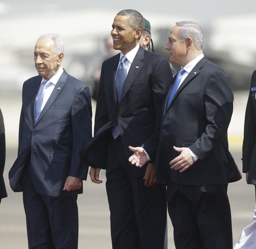President Barack Obama is greeted by Israeli President Shimon Peres, left, and Israeli Prime Minister Benjamin Netanyahu upon his arrival ceremony at Ben Gurion International Airport in Tel Aviv, Israel, on Wednesday.
