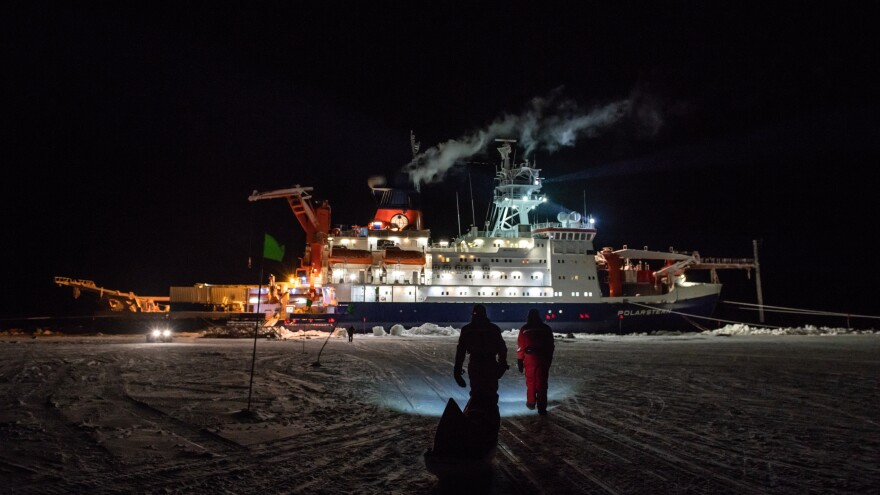 Researchers with the MOSAiC polar expedition inspect the ice in November. Life now feels surreal as they socialize normally, trying to imagine the global pandemic shutdown.