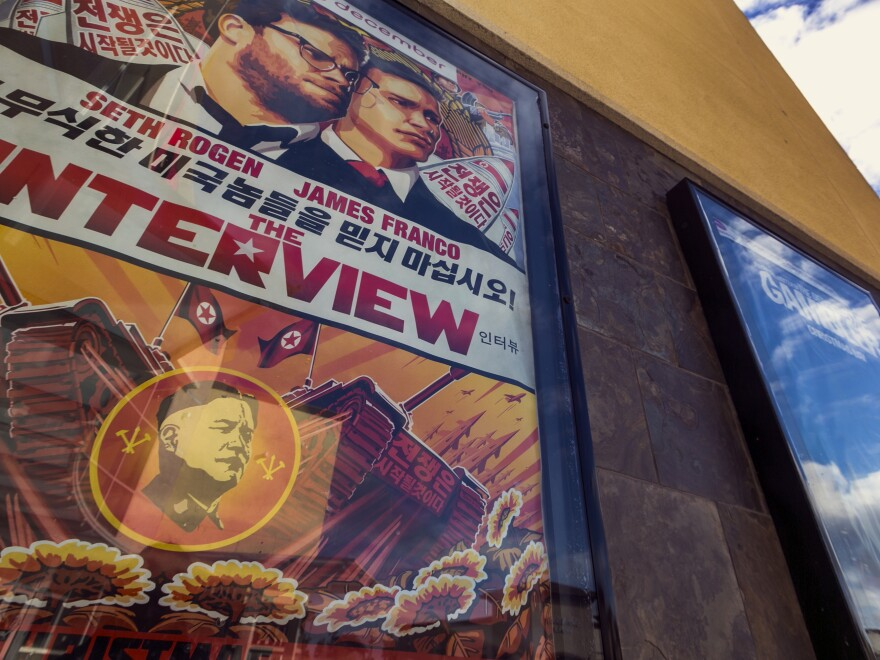 A poster for <em>The Interview</em> stands on display outside a movie theater in Glendora, Calif., on Wednesday.