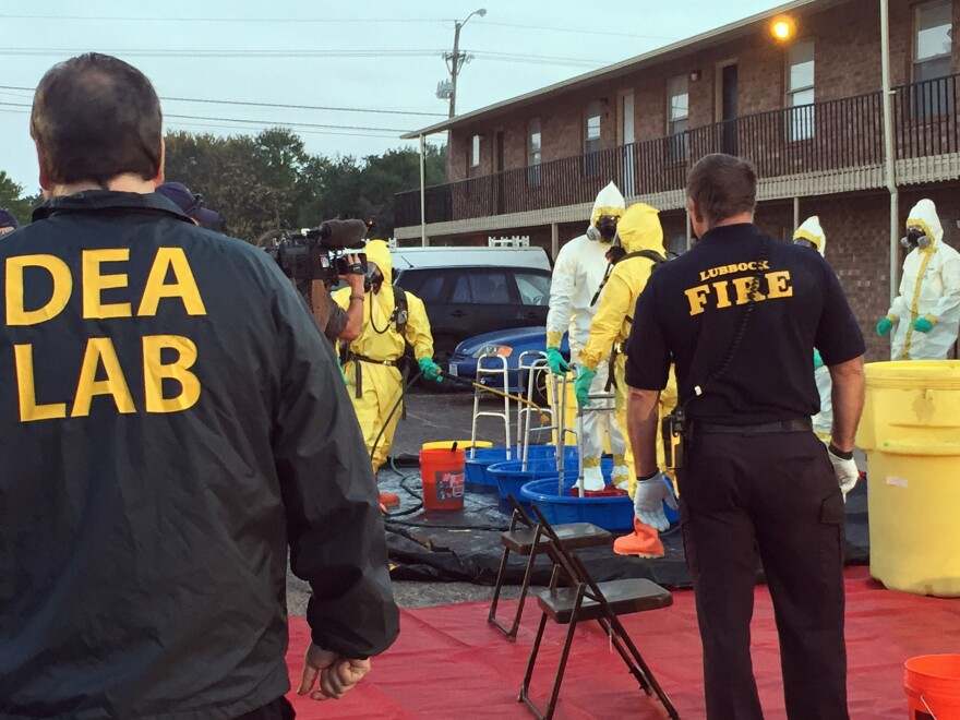 U.S. Drug Enforcement Agency, Lubbock Fire Department personnel help members of the DEA Hazardous Materials/Clandestine Laboratory Enforcement Team with a decontamination procedure in Lubbock, Texas in Oct. 2017.