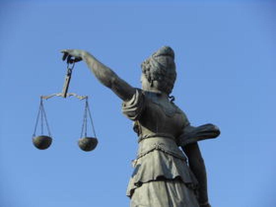 scales_of_justice_michael_coghlan.jpg