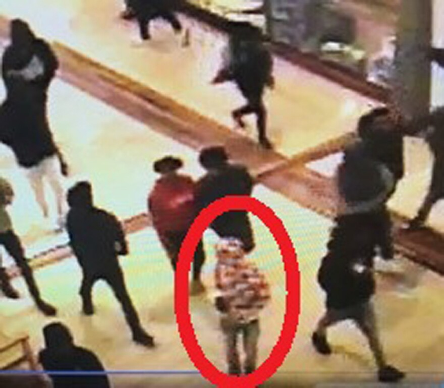 This is one of two images the Concord Police Department released of a man they call a suspect in the shooting. It's taken from the mall's security video.