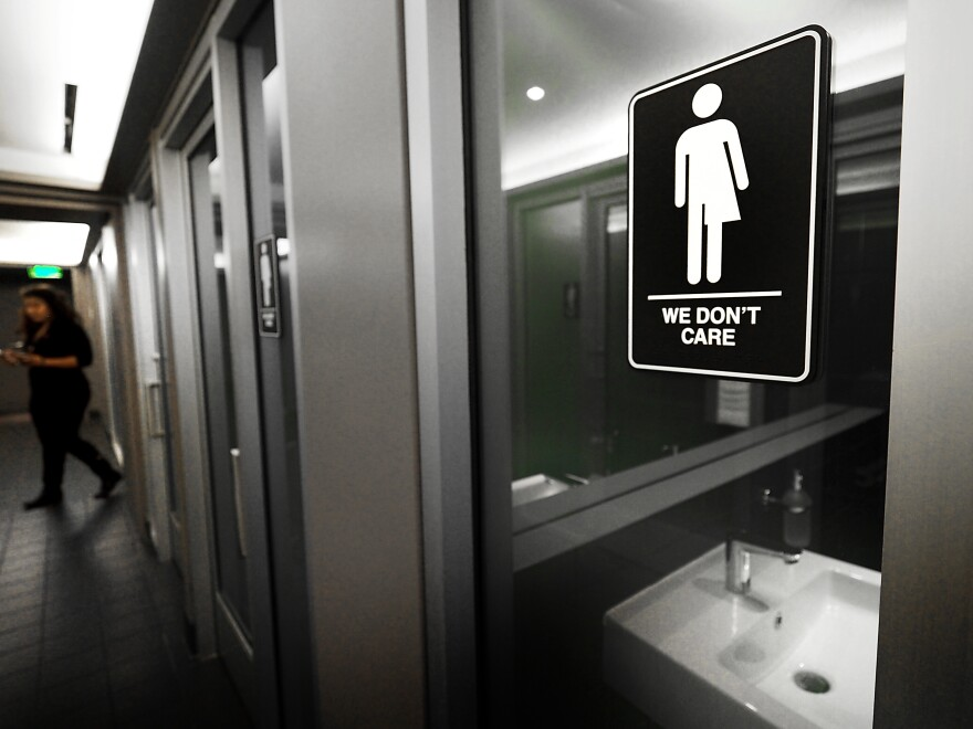 Gender-neutral signs are posted outside public restrooms at the 21c Museum Hotel in Durham, N.C. The Census Bureau says it is not planning to ask about gender identity or sexual orientation in the 2020 Census.