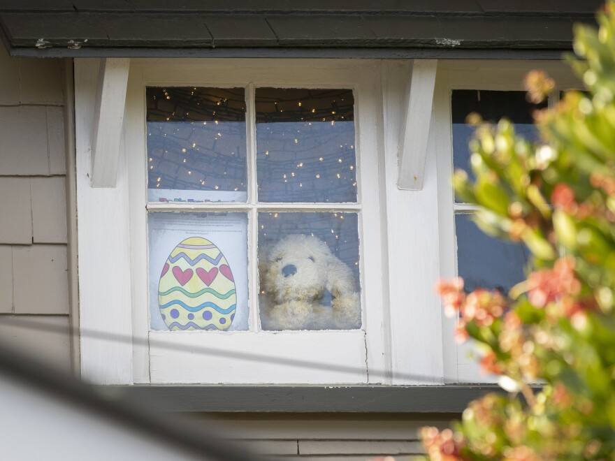 """""""You'll be pleased to know that we do consider both the tooth fairy and the Easter Bunny to be essential workers,"""" New Zealand Prime Minister Jacinda Ardern says, approving the rabbit's operations during a lockdown. Here, an Easter egg drawing is seen in the window of a home in an Auckland suburb of Mount Eden on Tuesday."""