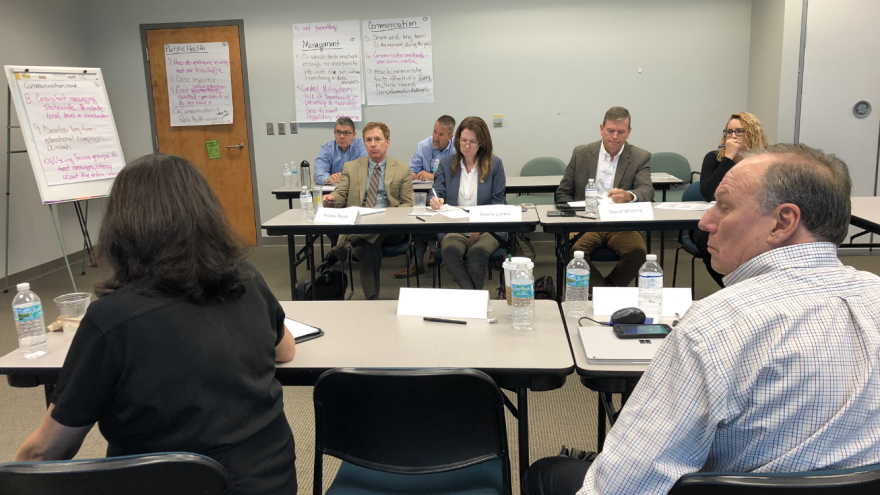 All but one of the 11 members of the Harmful Algal Bloom Task Force met at the Fish and Wildlife Research Institute in St. Petersburg on Thursday. Jessica Meszaros/WUSF