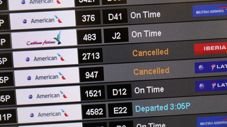 A sign at the Miami International Airport shows cancelled flights after American Airlines initially grounded its Boeing 737 Max  planes in March.