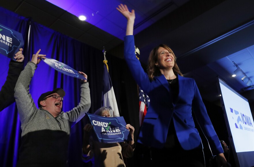 Cindy Axne, an Iowa Democrat, waves to the crowd after winning Iowa's 3rd Congressional District.