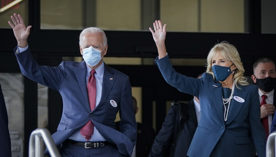 Democratic presidential nominee Joe Biden and his wife Jill Biden depart the Delaware State Building after casting their ballots for the general election on Wednesday in Wilmington.