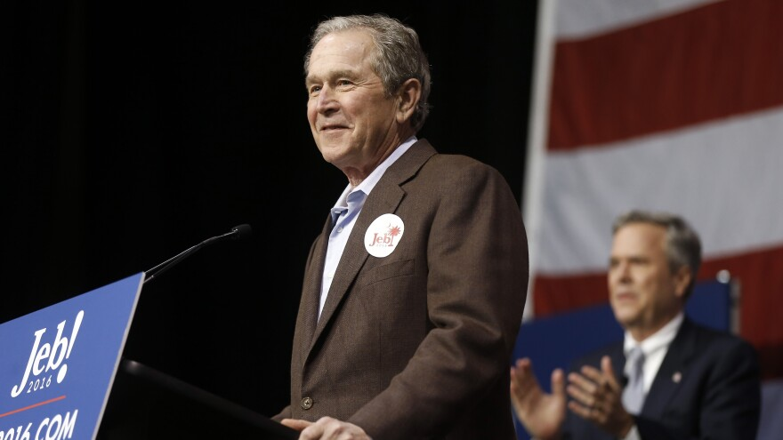 Former President George W. Bush (left) introduces his brother Jeb Bush during a campaign stop in South Carolina Monday.