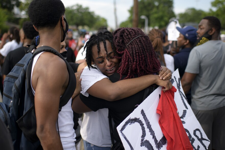 George Floyd's niece Gabrielle Thompson (center) cries as she hugs another woman during a Justice for George Floyd event in Houston on Saturday.