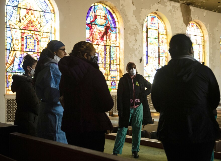 """Stanford speaks with volunteers ahead of the opening of a """"barrier free"""" COVID-19 test location outside Pinn Memorial Baptist Church in Philadelphia in April."""