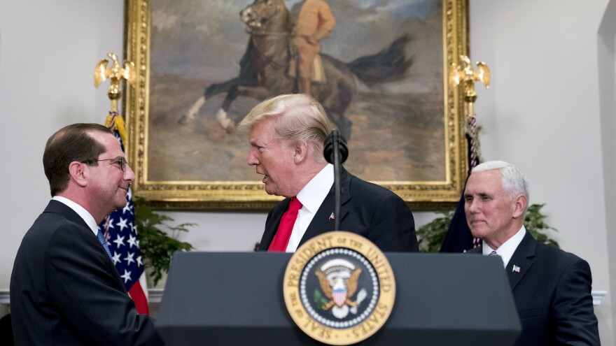 """President Trump shakes hands with Health and Human Services Secretary Alex Azar  after he is sworn in by Vice President Pence on Jan. 29. Major reproductive health organizations are voicing concerns about the Trump administration's new approach to federal family-planning grants, which may reduce the role of Planned Parenthood and place greater emphasis on """"natural family planning."""""""