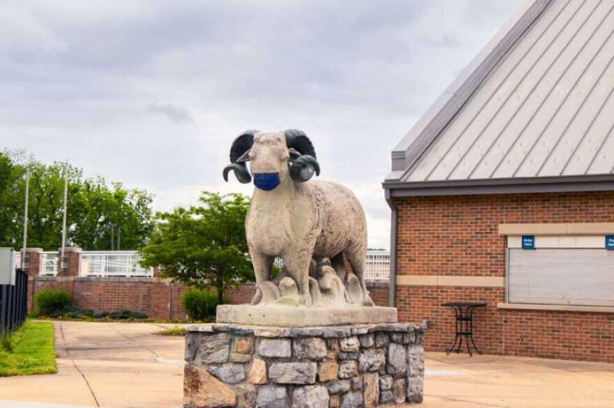 A statue of Shepherd University's mascot wears a face mask outside the football field during the coronavirus pandemic.