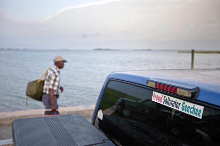 A sticker celebrating the Geechee heritage is seen on a pickup truck as passengers board a ferry to the mainland from Sapelo Island, Ga. (David Goldman/AP)