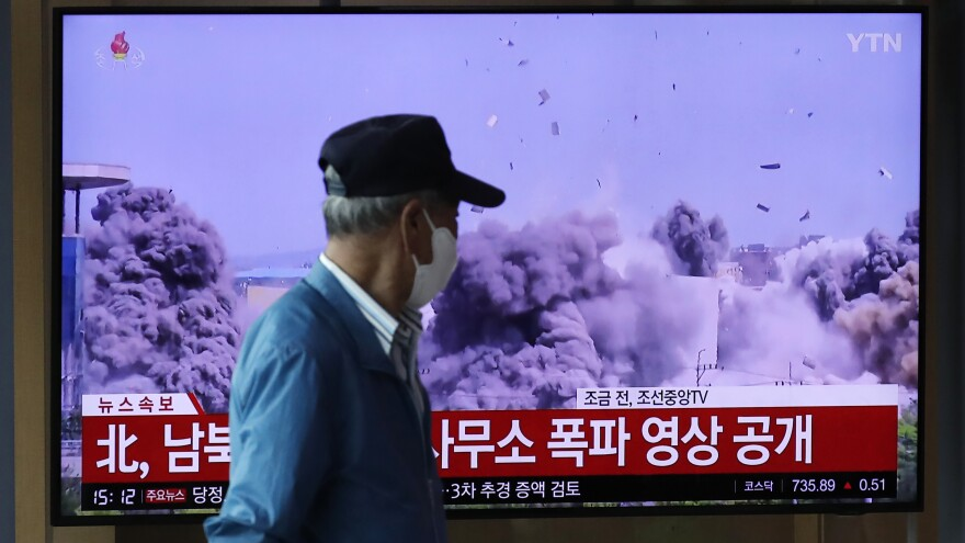 A man watches a television screen showing a news program with video of the demolition of the inter-Korean liaison office building in Kaesong, North Korea, at the Seoul Railway Station on Wednesday.