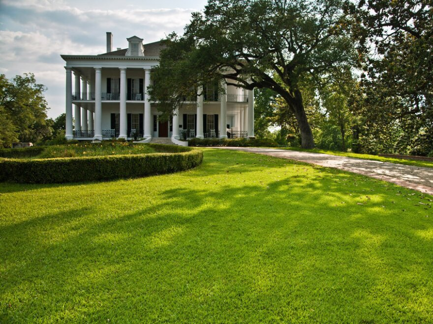 During the Civil War, Natchez surrendered to Union troops without a shot fired. Because of that, many of its elaborate, antebellum mansions — like the Dunleith, pictured here — survived the war.