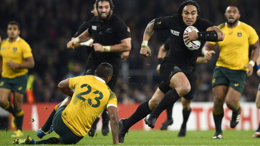 Ma'a Nonu of New Zealand runs to score a try during the Rugby World Cup final against Australia at Twickenham Stadium in London Saturday.